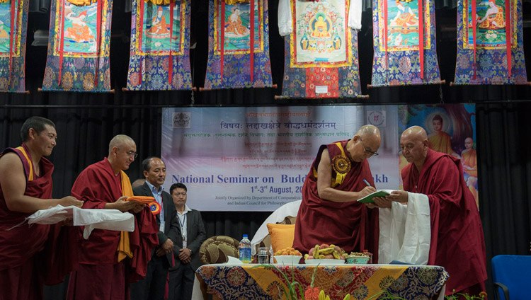His Holiness the Dalai Lama releasing three books at the start of the seminar on 'Buddhism in Ladakh' at the Central Institute of Buddhist Studies in Leh, Ladakh, J&K, India on August 1, 2017. Photo by Tenzin Choejor/OHHDL
