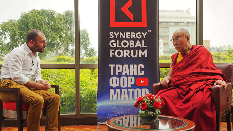 Grigory Avetov, CEO of Synergy Business School, Russia talking to His Holiness the Dalai Lama in Delhi, India on August 3, 2017. Photo by Jeremy Russell/OHHDL