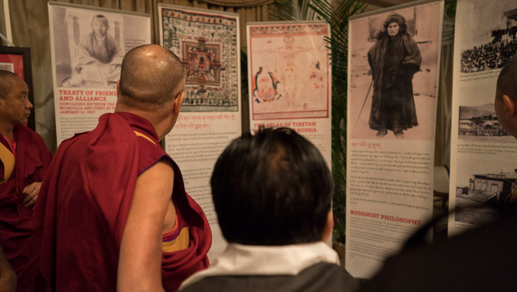 His Holiness the Dalai Lama looking at an exhibition focused on Agvan Dorjiev on his arrival at the hall for the dialogue between Russian and Buddhist scholars in New Delhi, India on August 7, 2017. Photo by Tenzin Choejor/OHHDL