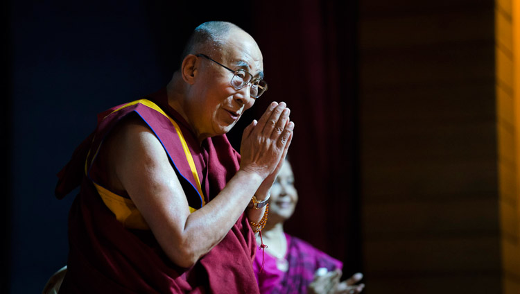 His Holiness the Dalai Lama paying respects to the audience after being introduced before delivering the Rajendra Mathur Memorial Lecture in New Delhi, India on August 9, 2017. Photo by Tenzin Choejor/OHHDL