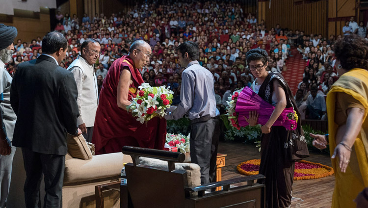 The welcoming committee of the Association of British Scholars offering His Holiness the Dalai Lama garlands of flowers at the start of his talk at the Siri Fort Auditorium in New Delhi, India on August 10, 2017. Photo by Tenzin Choejor/OHHDL