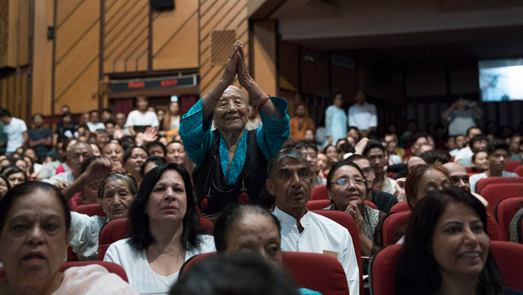 An elderly Tibetan paying respects to His Holiness the Dalai Lama as he addresses the Tibetans in the audience after his talk at the Siri Fort Auditorium in New Delhi, India on August 10, 2017. Photo by Tenzin Choejor/OHHDL