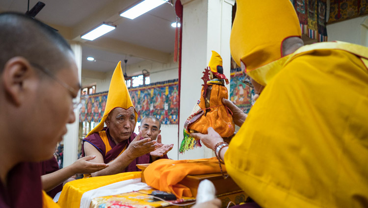 His Holiness the Dalai Lama installing the new Ganden Tripa before the start of his teaching at the Tsuglagkang in Dharamsala, HP, India on August 29, 2017. Photo by Tenzin Choejor/OHHDL