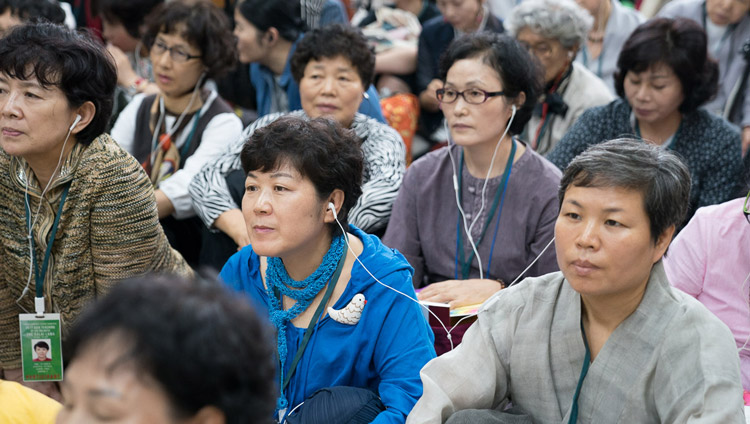 Members of the audienc listening to translations on FM radio during the second day of His Holiness the Dalai Lama's teachings for SE Asians at the Tsuglagkhang in Dharamsala, HP, India on August 30, 2017. PHoto by Ven Lobsang Kunga/OHHDL