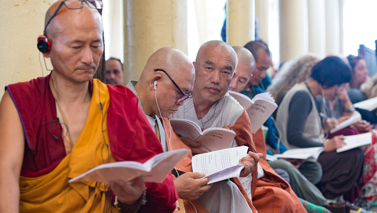 Members of the audience form SE Asia following the text during His Holiness the Dalai Lama's third day of teachings at the Tsuglagkhang in Dharamsala, HP, India on August 31, 2017. Photo by Tenzin Choejor/OHHDL