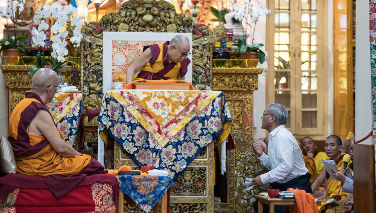His Holiness the Dalai Lama's English translator reading questions from the audience during the third day of teachings at the Tsuglagkhang in Dharamsala, HP, India on August 31, 2017. Photo by Tenzin Phuntsok/OHHDL
