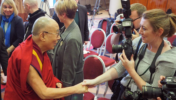 His Holiness the Dalai Lama shaking hands with journalists at the conclusion of their meeting in Derry, Northern Ireland, UK on September 11, 2017. Photo by Jeremy Russell/OHHDL