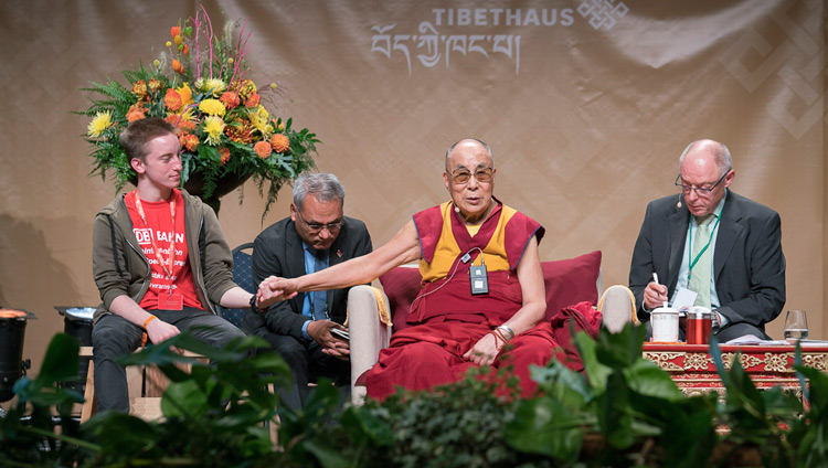 His Holiness the Dalai Lama answering questions from students during their dialogue at the Jahrhunderthalle in Frankfurt, Germany on September 13, 2017. Photo by Tenzin Choejor