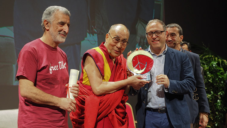 His Holiness the Dalai Lama receiving Messina's 'Builder of Peace, Justice and Nonviolence Prize' during his talk at the Vittorio Emanuele Theatre in Messina, Sicily, Italy on September 17, 2017. Photo by Jeremy Russell