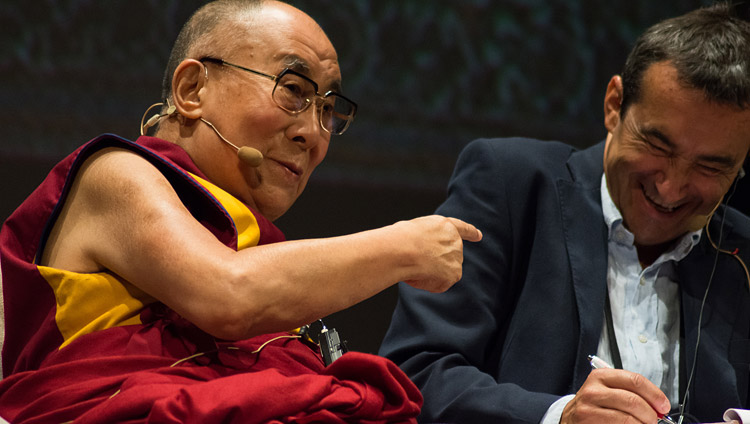 His Holiness the Dalai Lama gesturing at his Italian Translator Fabrizio Pallotti during his talk at he Vittorio Emanuele Theatre in Messina, Sicily, Italy on September 17, 2017. hoto by Federico Vinci/Città Metropolitana di Messina