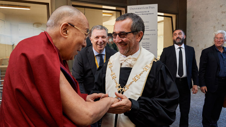 University of Pisa Rector Prof Paolo Mancarella welcoming His Holiness the Dalai Lama on his arrival at Pisa Congress Hall in Pisa, Italy on September 21, 2017. Photo by Olivier Adam