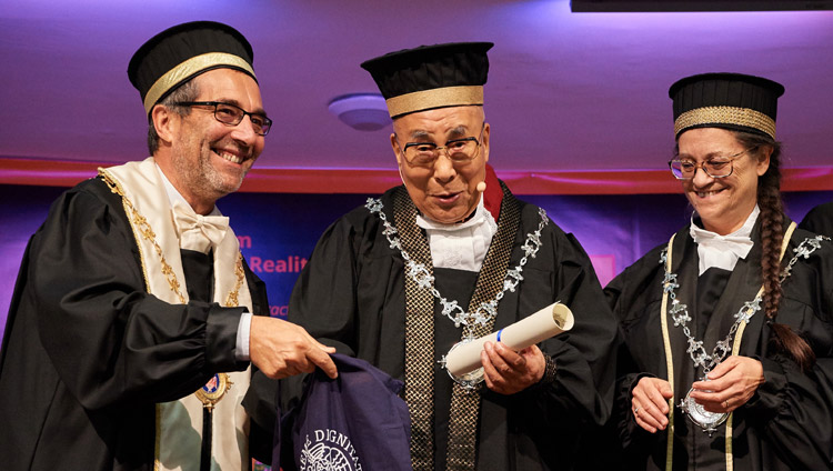 His Holiness the Dalai Lama receiving the Master's Degree Honoris Causa in Clinical and Health Psychology at the University of Pisa in Pisa, Italy on September 21, 2017. Photo by Olivier Adam