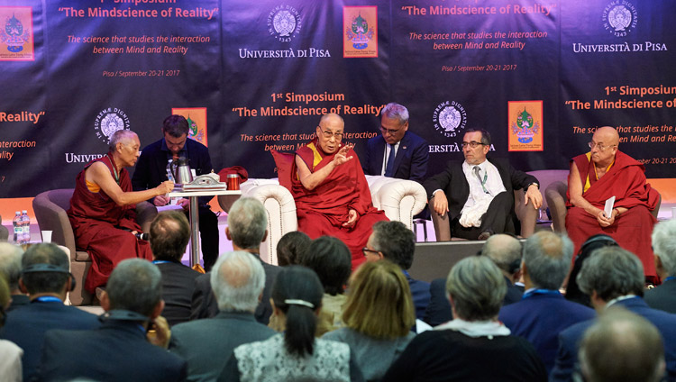 His Holiness the Dalai Lama commenting on the presentations during the second session of the MindScience Symposium at the University of Pisa in Pisa, Italy on September 21, 2017. Photo by Olivier Adam