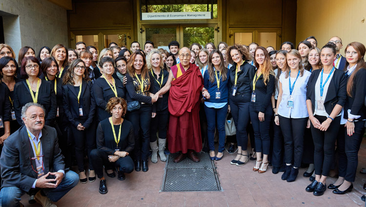 His Holiness the Dalai Lama with volunteers who helped during the two days of programs at the Pisa Congress Hall at the University of Pisa in Pisa, Italy on September 21, 2017. Photo by Olivier Adam