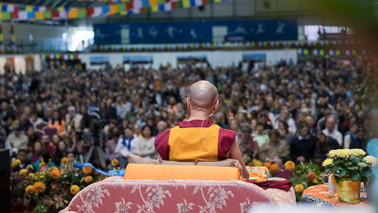 A view from the back of the stage on the second day of His Holiness the Dalai Lama's teachings at Skonto Hall in Riga, Latvia on September 24, 2017. Photo by Tenzin Choejor