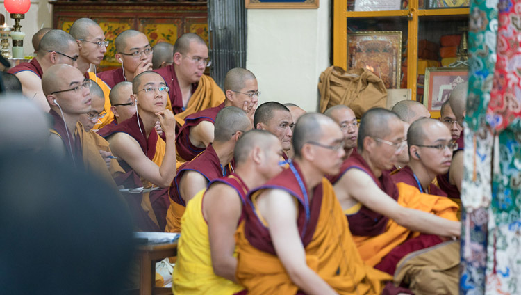 Monastics from Taiwan listening to the Chinese translation on FM radios of His Holiness the Dalai Lama'a teaching at the Tsuglagkhang in Dharamsala, HP, India on October 3, 2017. Photo by Tenzin Choejor