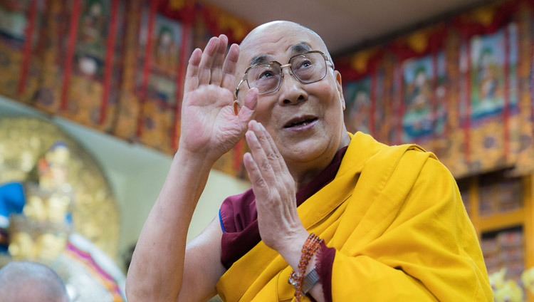 His Holiness the Dalai Lama waving at the audience on his arrival at the Tsuglagkhang on the second day of his teachings in Dharamsala, HP, India on October 4, 2017. Photo by Tenzin Choejor