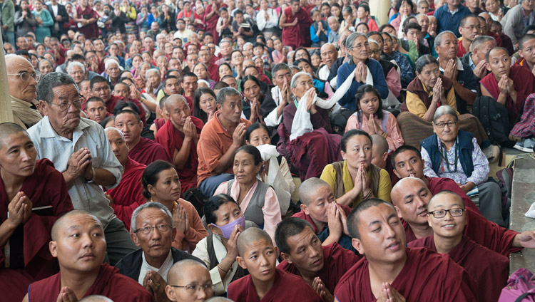 Many of the more the more than 6000 people attending His Holiness the Dalai Lama's second day of teachings waiting in the courtyard to pay their respects as he departs from the Tsuglagkhang in Dharamsala, HP, India on October 4, 2017. Photo by Tenzin Choejor
