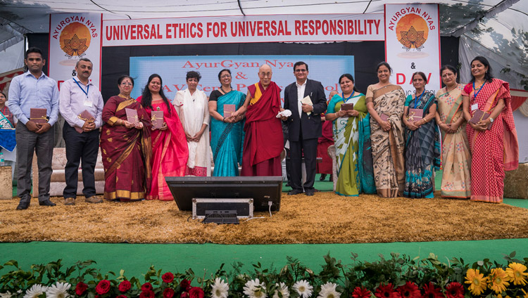 His Holiness the Dalai Lama and representatives from 9 schools releasing the Universal Ethics Curriculum prepared by Ayurgyan Nyas during the program at CJ DAV Public School in Meerut, UP, India on October 16, 2017. Photo by Tenzin Choejor