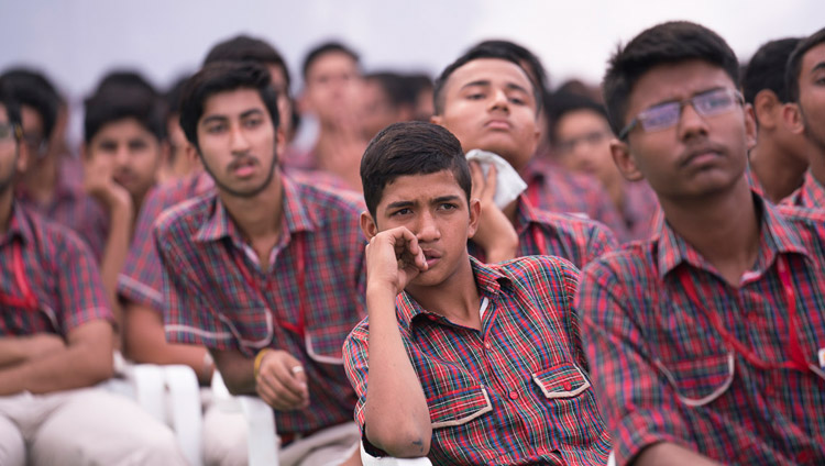 Students attending the launch of the Universal Ethics Curriculum listening to His Holiness the Dalai Lama at CJ DAV Public School in Meerut, UP, India on October 16, 2017. Photo by Tenzin Choejor