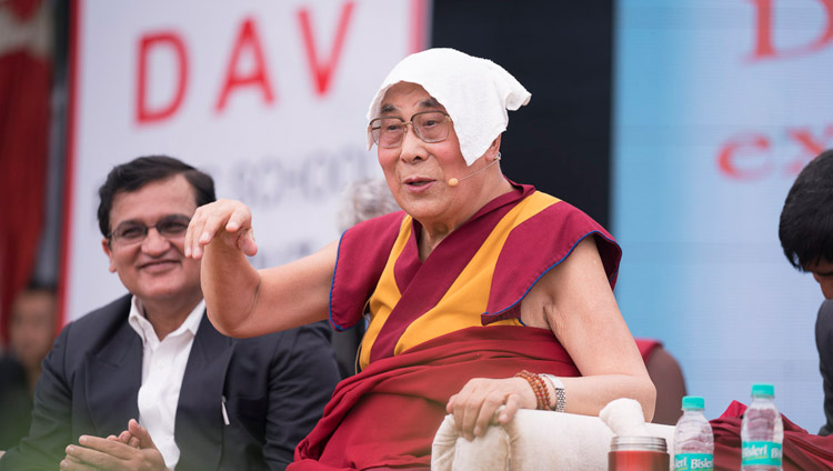 His Holiness the Dalai Lama speaking at the launch of a curriculum prepared by Ayurgyan Nyas introducing training in Universal Ethics at CJ DAV Public School in Meerut, UP, India on October 16, 2017. Photo by Tenzin Choejor