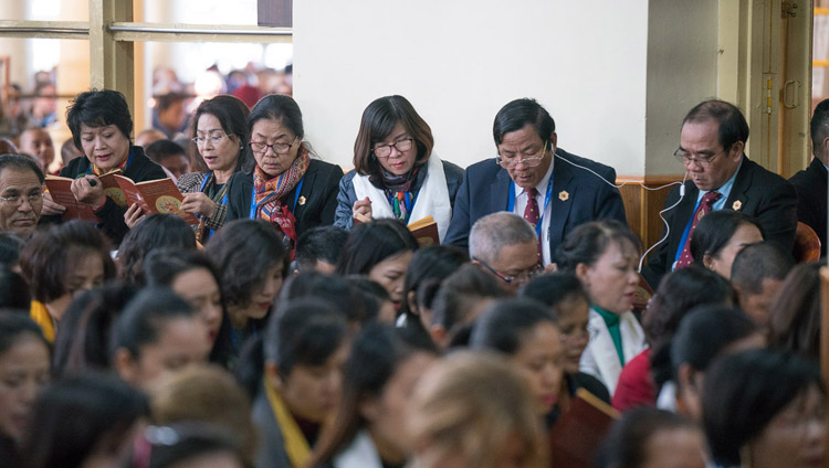 Sponsors and supporters of the new Namgyal Monastery school reciting the 'Heart Sutra' at the start of His Holiness the Dalai Lama's teachings at the Main Tibetan Temple in Dharamsala, HP, India on November 3, 2017. Photo by Tenzin Choejor