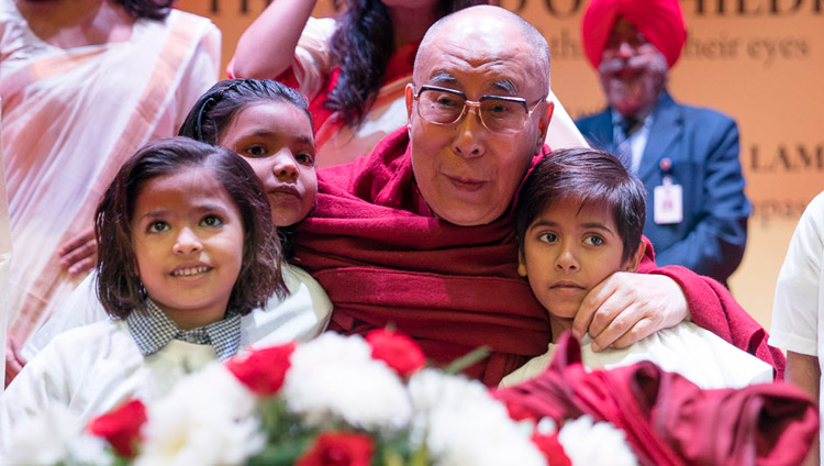 His Holiness the Dalai Lama with young children supported by the Smile Foundation before his talk at the NCUI Auditorium in New Delhi, India on November 19, 2017. Photo by Tenzin Choejor