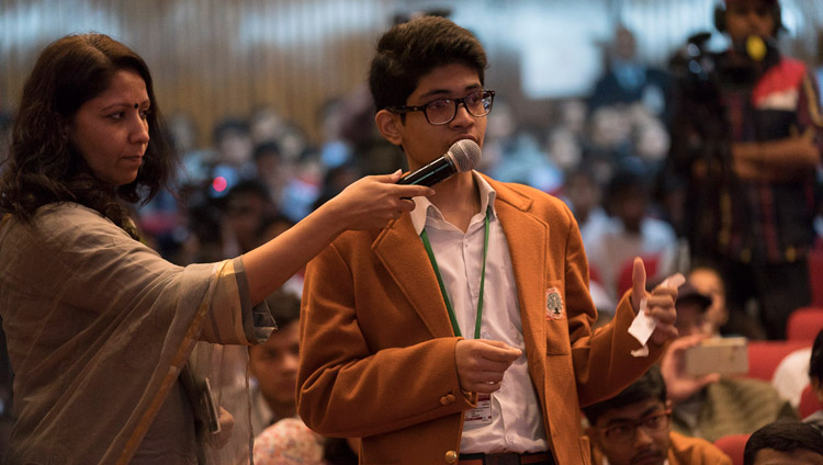 A student asking His Holiness the Dalai Lama a question during his talk hosted by the Smile Foundation at the NCUI Auditorium in New Delhi, India on November 19, 2017. Photo by Tenzin Choejor