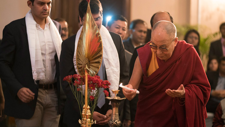 His Holiness the Dalai Lama lighting an lamp to open his talk to members of the Indian Chamber of Commerce in Kolkata, India on November 23, 2017. Photo by Tenzin Choejor