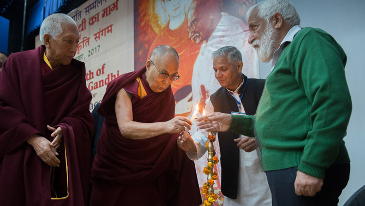 His Holiness the Dalai Lama joins in lighting a lamp to open the Convention for Global Peace at the Government College in Dharamsala, HP, India on December 2, 2017. Photo by Lobsang Tsering