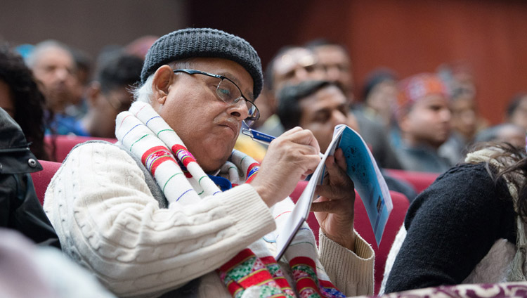 A member of the audience taking notes as His Holiness the Dalai Lama addresses the Convention for Global Peace at the Government College in Dharamsala, HP, India on December 2, 2017. Photo by Lobsang Tsering