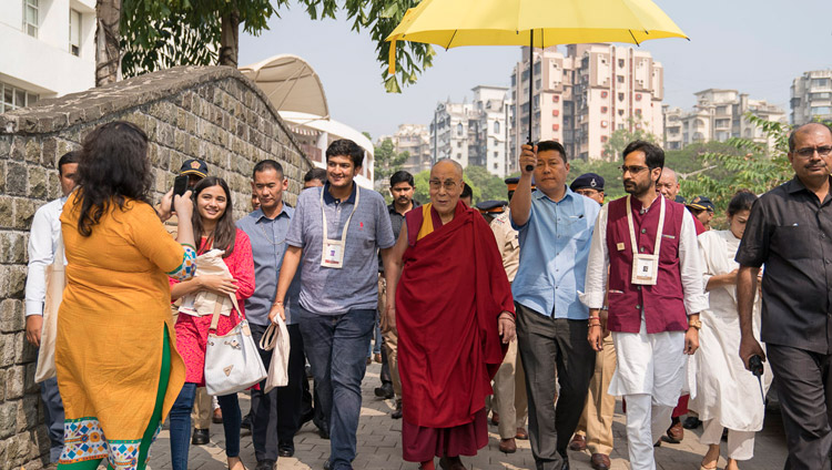His Holiness the Dalai Lama escorted by his hosts walking to lunch at the conclusion of the first day of teachings at Somaiya Campus Auditorium in Mumbai, India on December 8, 2017. Photo by Lobsang Tsering