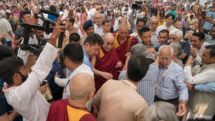 His Holiness the Dalai Lama making his way through the crowd of over 2000 on his way to the dias to begin his talk at Somaiya Vidyavihar in Mumbai, India on December 10, 2017. Photo by Lobsang Tsering