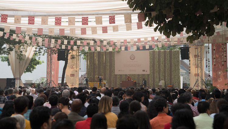 Members of the audience listening to His Holiness the Dalai Lama speaking at ccA view of the stage set up under a large awning, venue for His Holiness the Dalai Lama's talk at Somaiya Vidyavihar in Mumbai, India on December 10, 2017. Photo by Lobsang Tsering