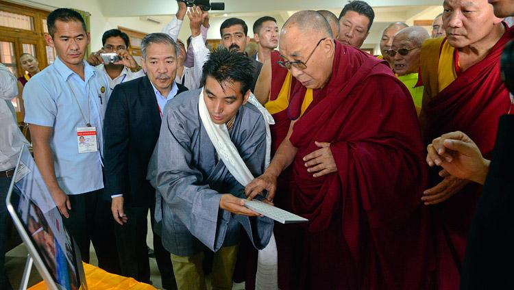 His Holiness the Dalai Lama launching the Meditation & Science Center's new website at Drepung Loseling Monastery, Mundgod, Karnataka, India on December 14, 2017. Photo by Lobsang Tsering