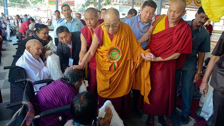 His Holiness the Dalai Lama greeting elderly Tibetans as he arrives at the new debate yard at Jangchub Choeling Nunnery in Mundgod, Karnataka, India on December 15, 2017. Photo by Lobsang Tsering