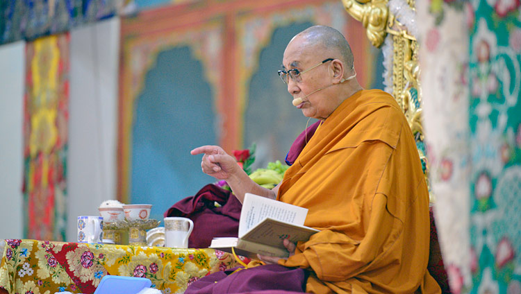 "His Holiness the Dalai Lama commenting on the text ""Three Principal Aspects of the Path"" during his teaching at Ganden Lachi Monastery in Mundgod, Karnataka, India on December 17, 2017. Photo by Lobsang Tsering"