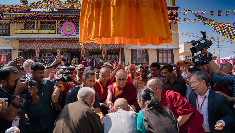 His Holiness the Dalai Lama greeting members of the Tibetan community on his arrival at Sera Lachi Monastery in  Bylakuppe, Karnataka, India on December 19, 2017. Photo by Tenzin Choejor