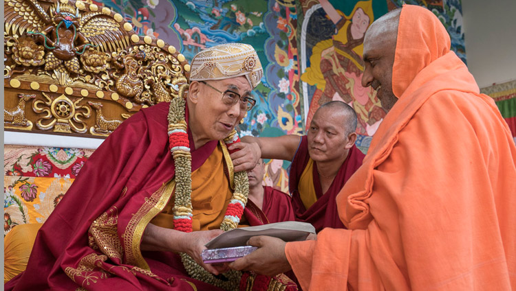 One of the chief guests, Jagadguru Sri Shivarathri, offering His Holiness the Dalai Lama a shawl, a garland and a turban as a token of appreciation during the inauguration ceremony for the new debate courtyard at Sera Mey Monastery in Bylakuppe, Karnataka, India on December 21, 2017. Photo by Lobsang Tsering