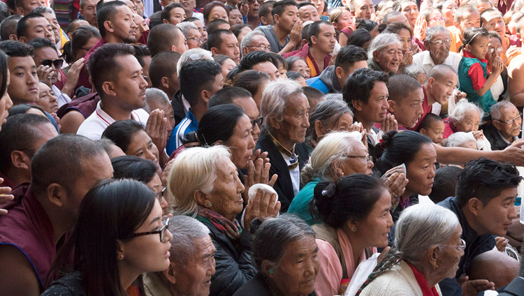 Members of the Tibetan community watching His Holiness the Dalai Lama depart at the conclusion of the inauguration of the new Sera Mey Monastery debate courtyard in Bylakuppe, Karnataka, India on December 21, 2017. Photo by Lobsang Tsering