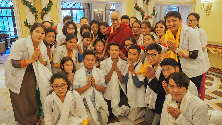 His Holiness the Dalai Lama with group of 25 Tibetan youths who help Tibetan patients who come from the Tibetan settlements for treatment in Bengaluru after their meeting in Bengaluru, Karnataka, India on December 24, 2017. Photo by Jeremy Russell