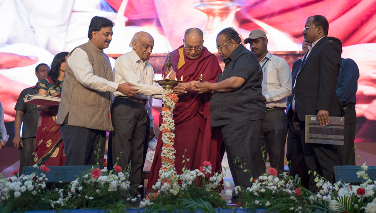 His Holiness the Dalai Lama joins in lighting a lamp at the start of the Seshadripuram Group of Institutions Silver Jubilee in Bengaluru, Karnataka, India on December 24, 2017. Photo by Lobsang Tsering
