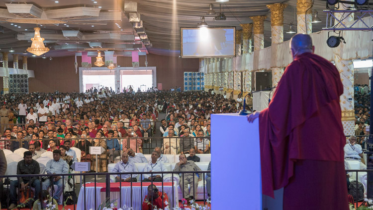 His Holiness the Dalai Lama speaking to the over 14,000 people attending Seshadripuram Group of Institutions Silver Jubilee in Bengaluru, Karnataka, India on December 24, 2017. Photo by Lobsang Tsering