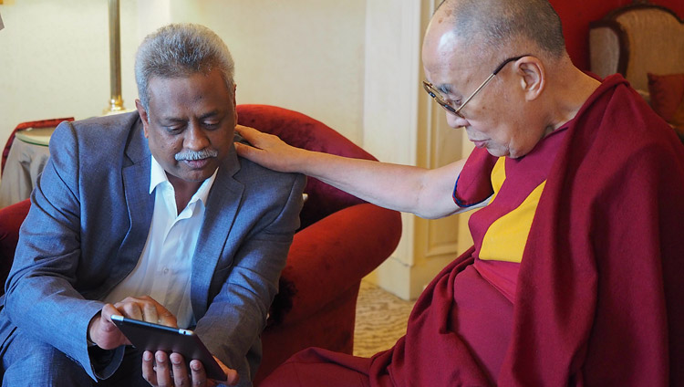 Bharath Subbarao demonstrating the new 'Mandala' app to His Holiness the Dalai Lama in Bengaluru, Karnataka, India on December 25, 2017. Photo by Jeremy Russell