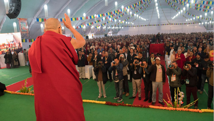 His Holiness the Dalai Lama waving to the audience on his arrival at the venue for the conference on Mind in Indian Philosophical Schools of Thought and Modern Science at the Central Institute of Higher Tibetan Studies in Sarnath, Varanasi, India on December 30, 2017. Photo by Lobsang Tsering