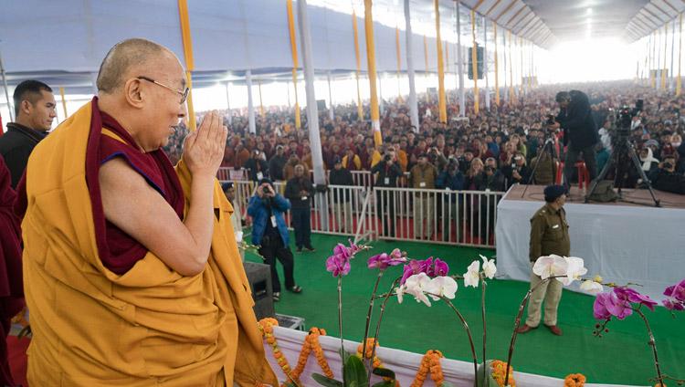 His Holiness the Dalai Lama acknowledging the crowd of over 50,000 on his arrival at the Kalachakra Maidan in Bodhgaya, Bihar, India on January 5, 2018. Photo by Lobsang Tsering