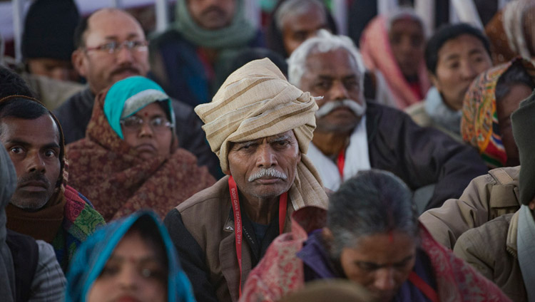 Members of the crowd listening to His Holiness the Dalai Lama on the first day of his teachings requested by Indian Buddhists at the Kalachakra Maidan in Bodhgaya, Bihar, India on January 5, 2018. Photo by Lobsang Tsering