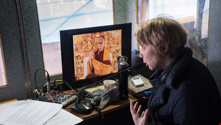 The Russian interpreter, one of 12 different translations available, working during the first day of His Holiness the Dalai Lama's teaching in Bodhgaya, Bihar, India on January 5, 2018. Photo by Lobsang Tsering
