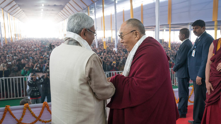 His Holiness the Dalai Lama and Bihar Chief Minister Nitish Kumar exchanging greetings at the start of the book release ceremony in Bodhgaya, Bihar, India on January 7, 2018. Photo by Lobsang Tsering