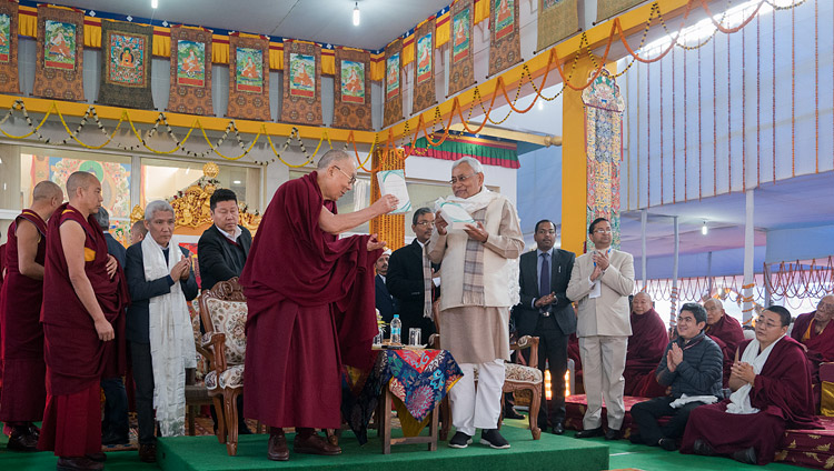 "His Holiness the Dalai Lama and Bihar Chief Minister Nitish Kumar releasing ""Science and Philosophy in the Indian Buddhist Classics, Vol. 1: The Physical World"" in Bodhgaya, Bihar, India on January 7, 2018. Photo by Lobsang Tsering"